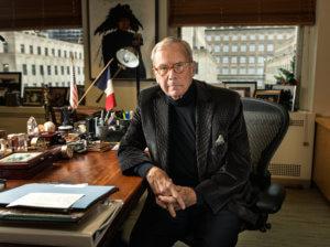 Tom Brokaw at desk