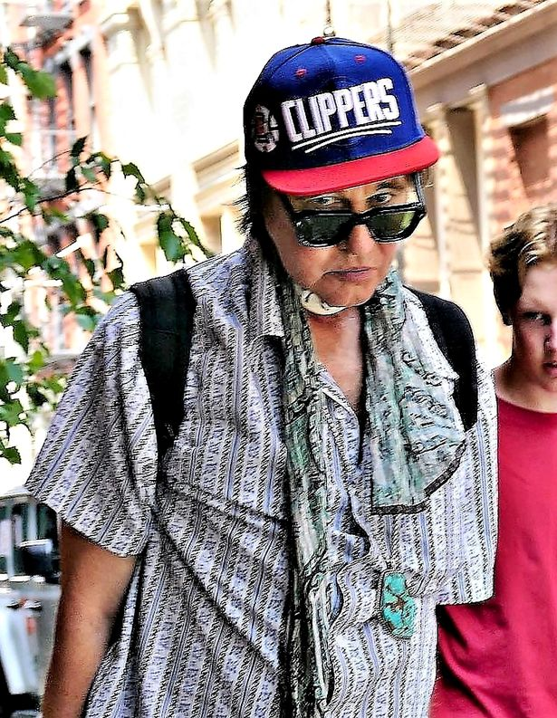 Kilmer was spotted in New York City with his Clippers hat, a patterned shirt, and what looks to be a tracheostomy device left from his throat cancer surgery