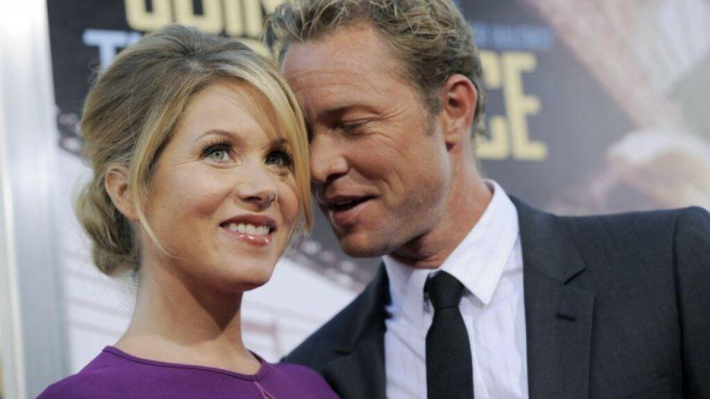 Christina Applegate smiling alongside her husband Martyn LeNoble