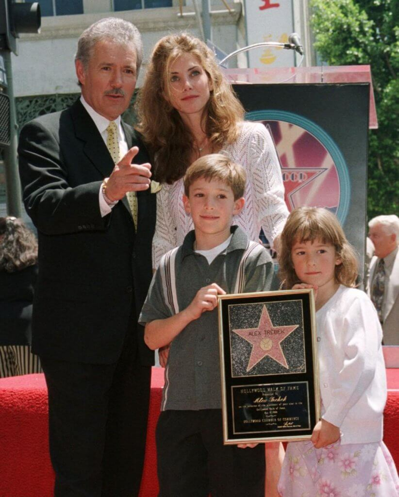 Alex and Jean Trebek posing with Hollywood star Wall of Fame with children Erin and Matthew Trebek