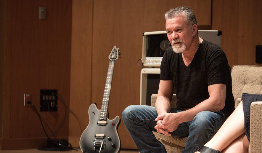 Eddie Van Halen sitting on a couch during an interview