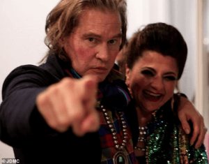 Val Kilmer looked lively and energetic posing with artist Tamie Adaya at his HelMel studio in Los Angeles