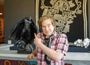 Val Kilmer posing in front of a batman figurine on his instagram