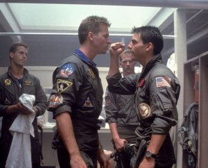 Val Kilmer and Tom Cruise in 1986 portraying their characters as Navy Fighter Pilots in Top Gun