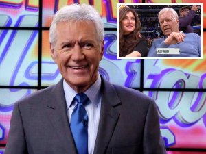 Alex Trebek smiling as he hosts Jeopardy
