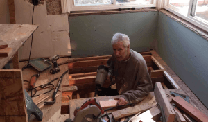 Alex Trebek pictured remodeling Jean Trebek's bathroom with many tools