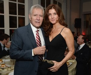 Alex and Jean Trebek posing at a dinner event