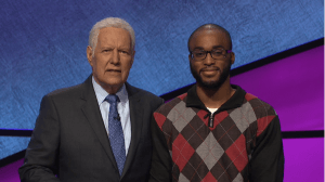 "Alex Trebek poses with ""Jeopardy!"" contestant Terry Heard, Jr."