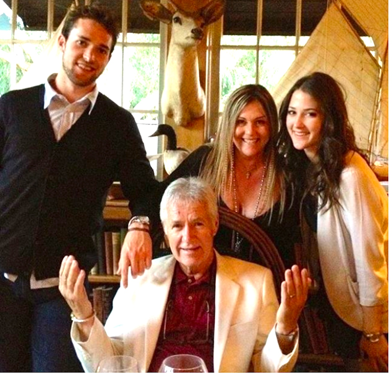 Alex Trebek is pictured having a father's day dinner with his children in their home